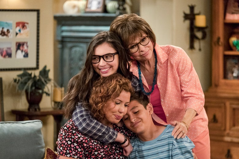 The cast of One Day at a Time embraces.