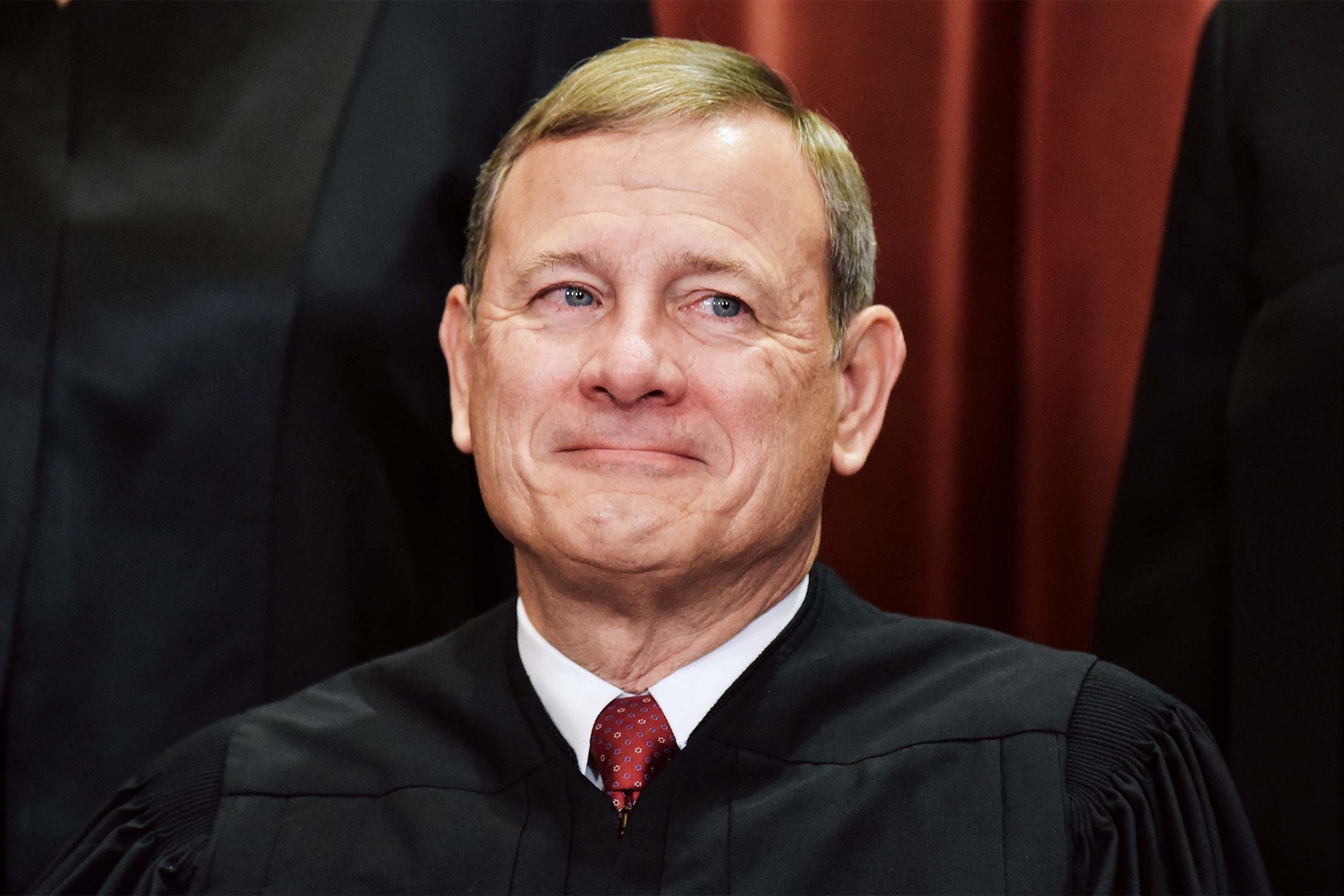 Chief Justice John Roberts poses for the official group photo at the U.S. Supreme Court in Washington on Nov. 30