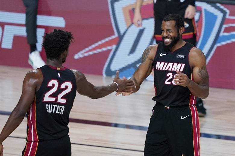 Jimmy Butler and Andre Iguodala of the Miami Heat celebrate together.