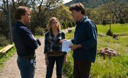 Photograph of Cameron Crowe giving direction to Matt Damon and Scarlett Johansson while filming 'We Bought a Zoo'