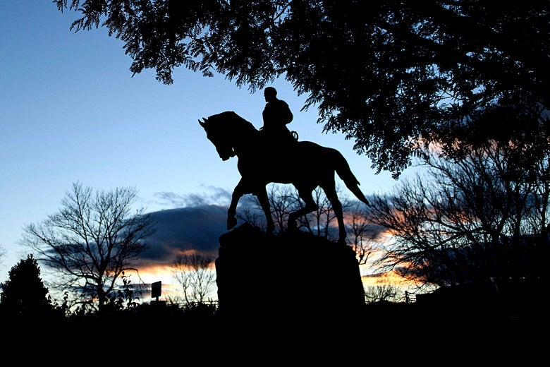 Silhouette of the statue at dusk