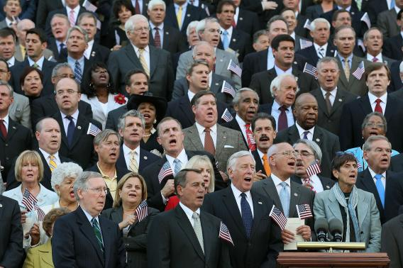 Members of the Congress sing 'God Bless America' during an event commemorating the tenth anniversary of the Sept. 11 terrorist attacks, on September 12, 2011 on Capitol Hill in Washington, DC.