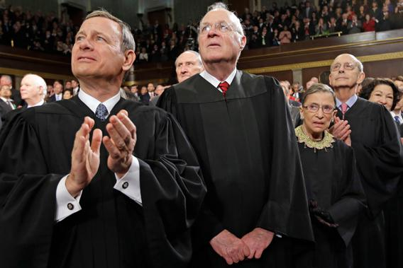 From left, Chief Justice John Roberts and Associate Justices Anthony Kennedy, Ruth Bader Ginsburg, Stephen Breyer and Sonia Sotomayor applaud before President Barack Obama's State of the Union address during a joint session of Congress on Capitol Hill in Washington, Tuesday Feb. 12, 2013.