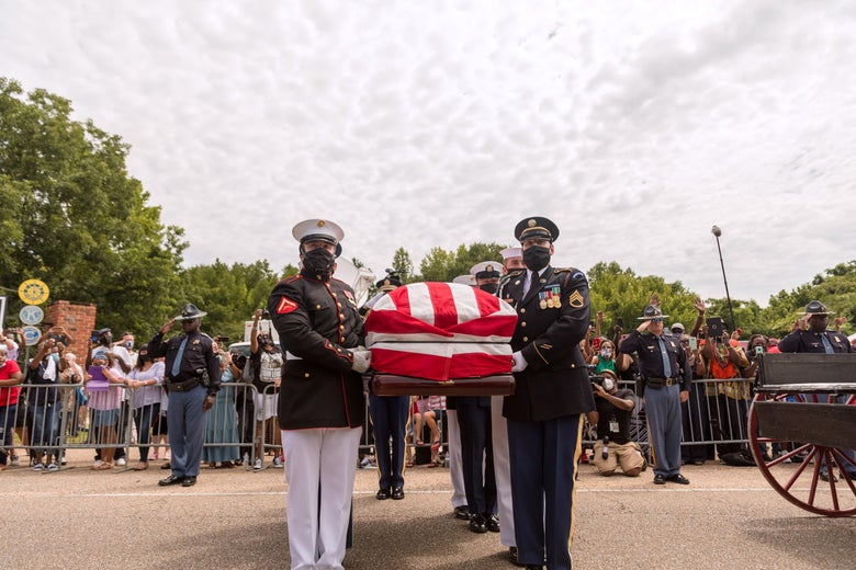 Military pallbearers prepare to place the body of former US Rep. John Lewis (D-GA) into a hearse after it was carried across Edmund Pettus Bridge on July 26, 2020 in Selma, Alabama.
