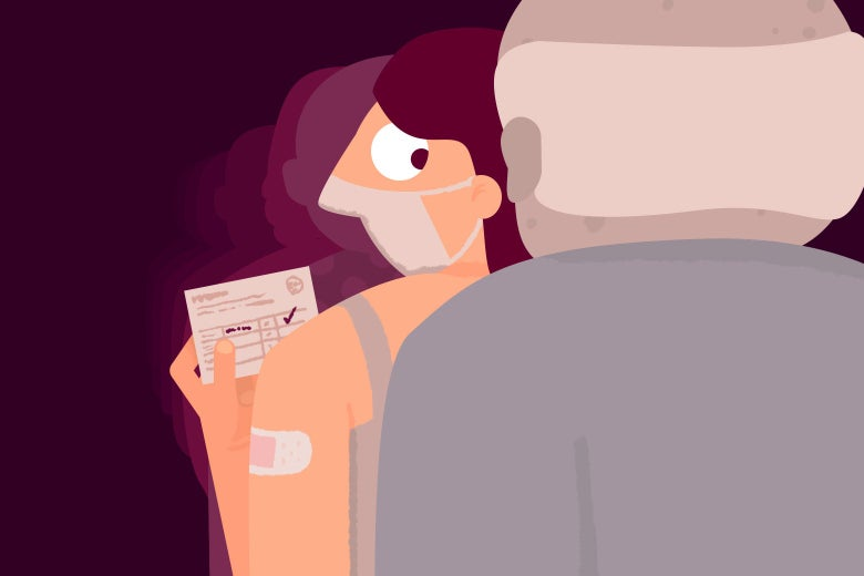 A woman holding a vaccine card with a Band-Aid on her arm looking behind her at an older man in line after her.