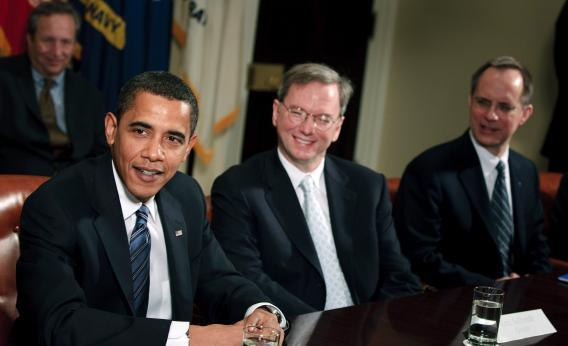 Barack Obama speaks in the Roosevelt Room of the White House as Eric Schmidt, CEO of Google, and David Barger, CEO of JetBlue, listen Jan. 28, 2009, in Washington D.C.