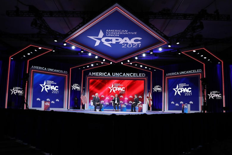 Three men seated on the CPAC stage