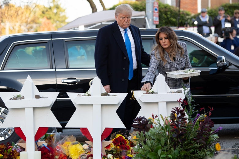 Donald Trump and his wife Melania along with Tree of Life's rabbi Jeffrey Myers, laying stones and flowers at memorials.