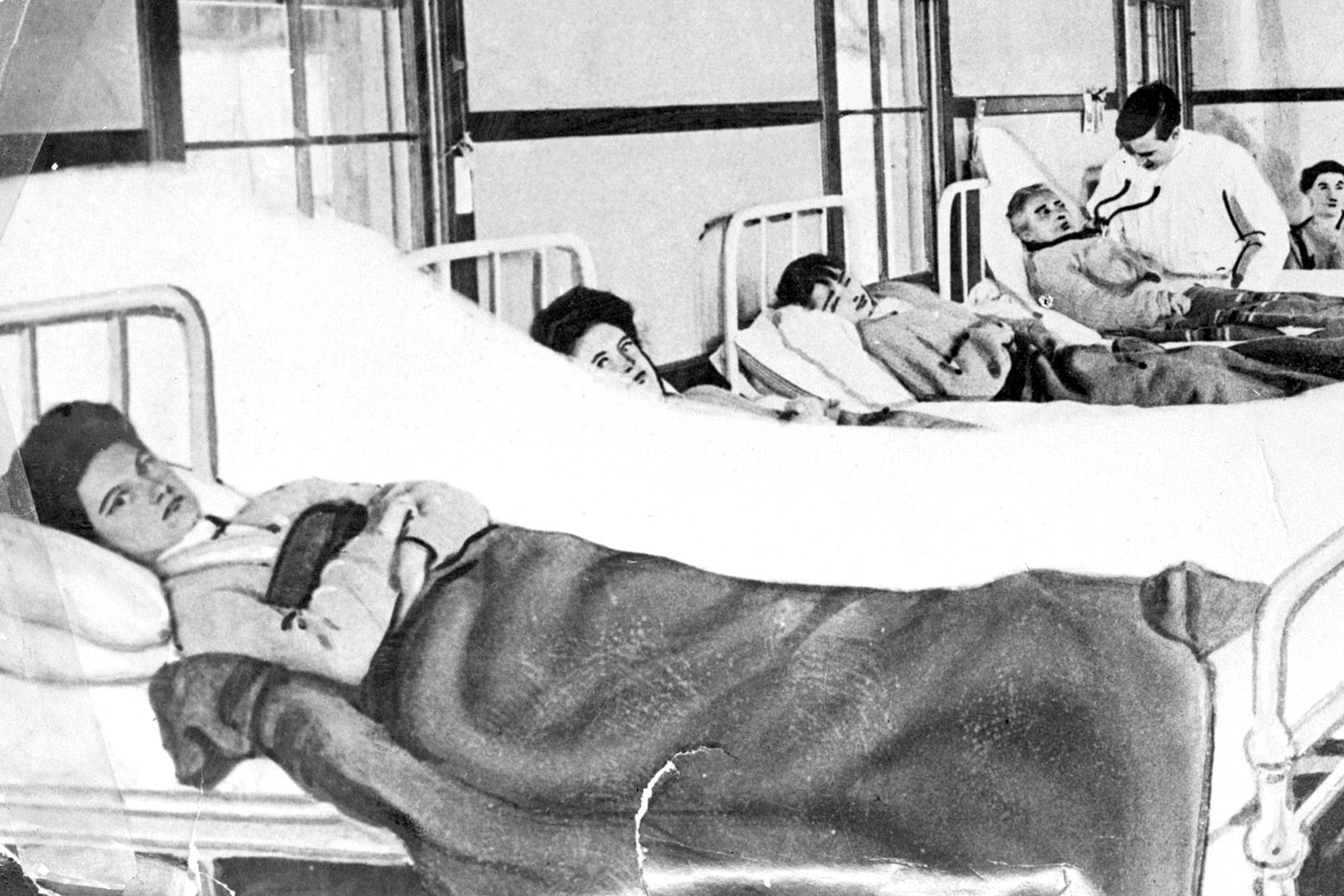 Mary Mallon and other patients in hospital beds.
