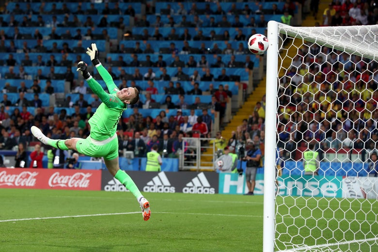 Jordan Pickford of England makes a save.