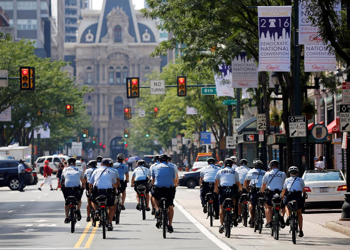 Police ride bicycles down Market Street toward City Hall ahead of the Democratic National Convention in Philadelphia, Pennsylvania, U.S., July 24, 2016.