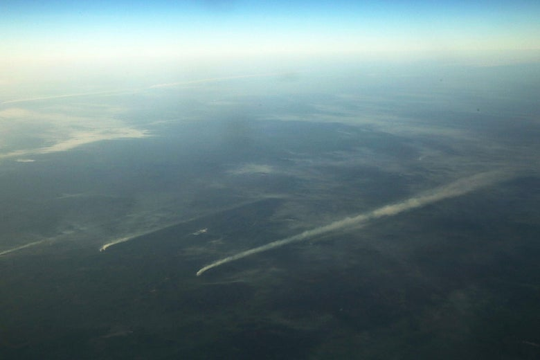 Overhead shot of lines of smoke coming from fires burning in the Amazon basin.