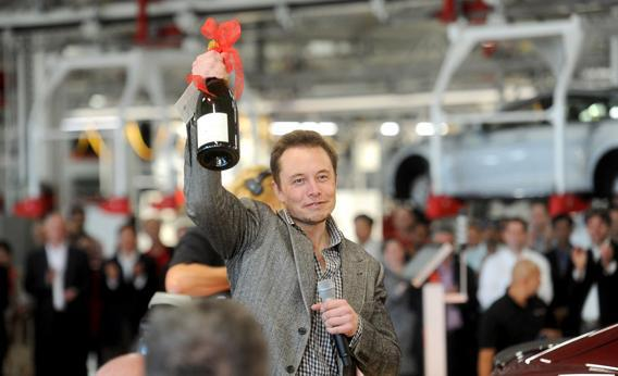 Tesla CEO Elon Musk celebrates at his company's factory in Fremont, Calif., June 22, 2012, as the car company began delivering its Model S electric sedan.