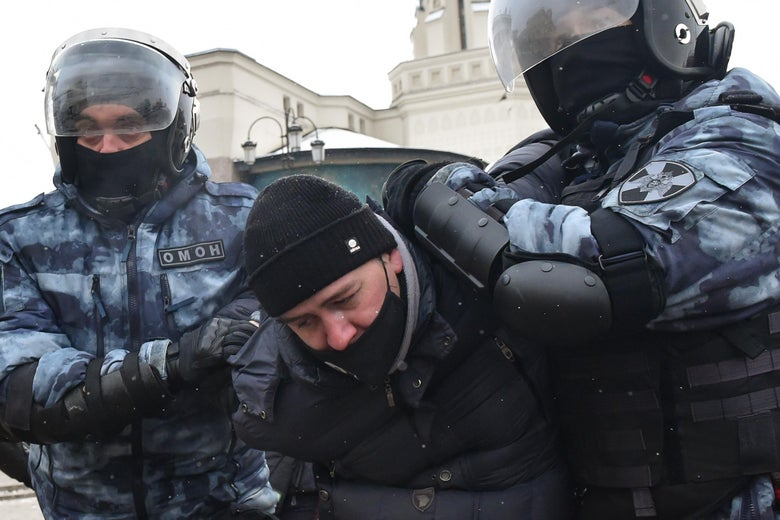 Riot police detain a man during a rally in support of jailed opposition leader Alexei Navalny in Moscow on January 31, 2021.