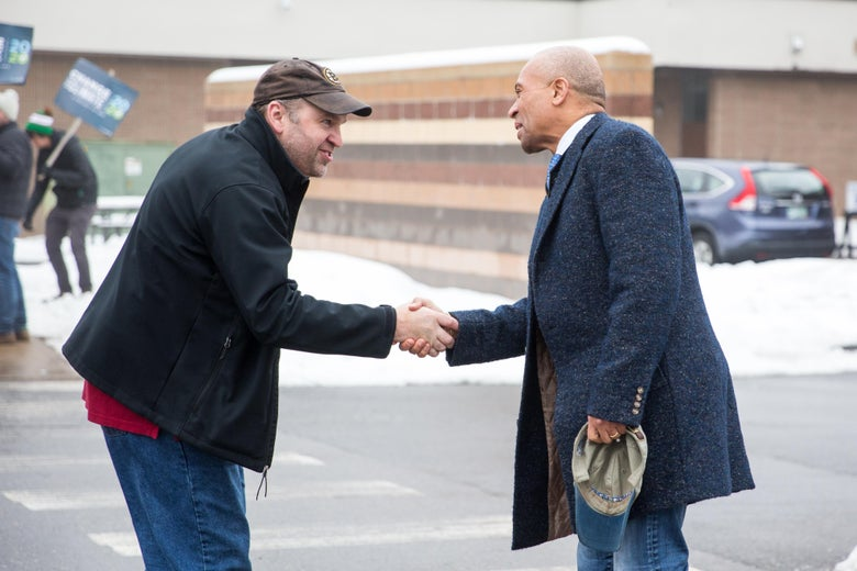 CONCORD, NH - FEBRUARY 11:  Democratic presidential candidate former Massachusetts Governor Deval Patrick reaches out to shake a single voter's hand in a parking lot.