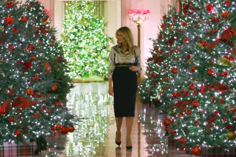 Melania Trump among Christmas trees.