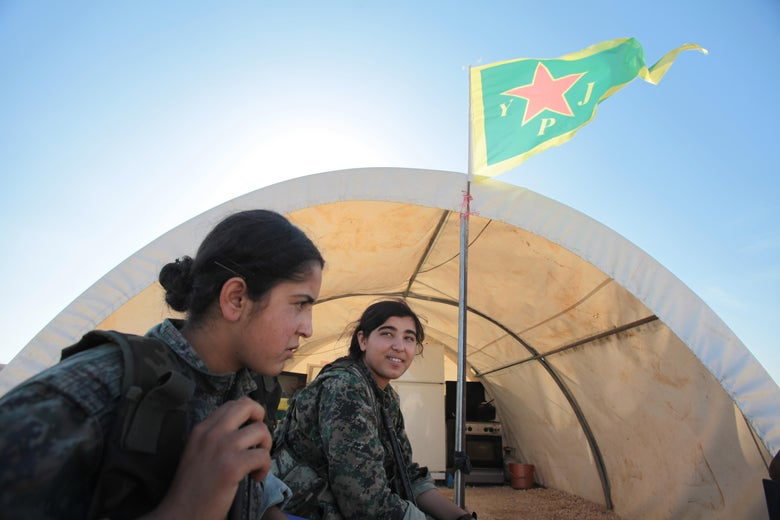 A Kurdish People's Protection Unit rests a base camp at the outskirts of the destroyed Syrian town of Kobane in 2015.