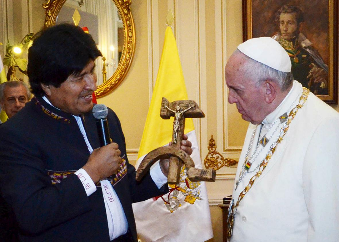 Bolivia's President Evo Morales, left, presents a figure of a cr