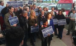 Michele Bachmann and supporters stand for a CNN interview in Nevada, Iowa.
