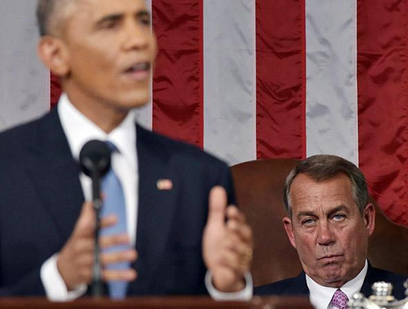 House Speaker John Boehner (R-OH) listens to President Obama deliver the State of the Union address.