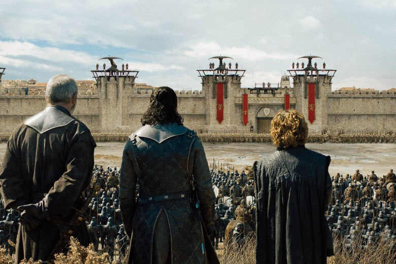 Davos, Jon, and Tyrion look toward the gates of King's Landing.