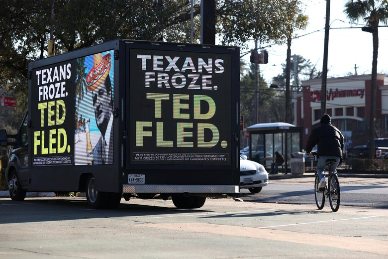 "A digital billboard truck features a picture of Ted Cruz in a souvenir sombrero and the text, ""TEXAS FROZE. TED FLED."""