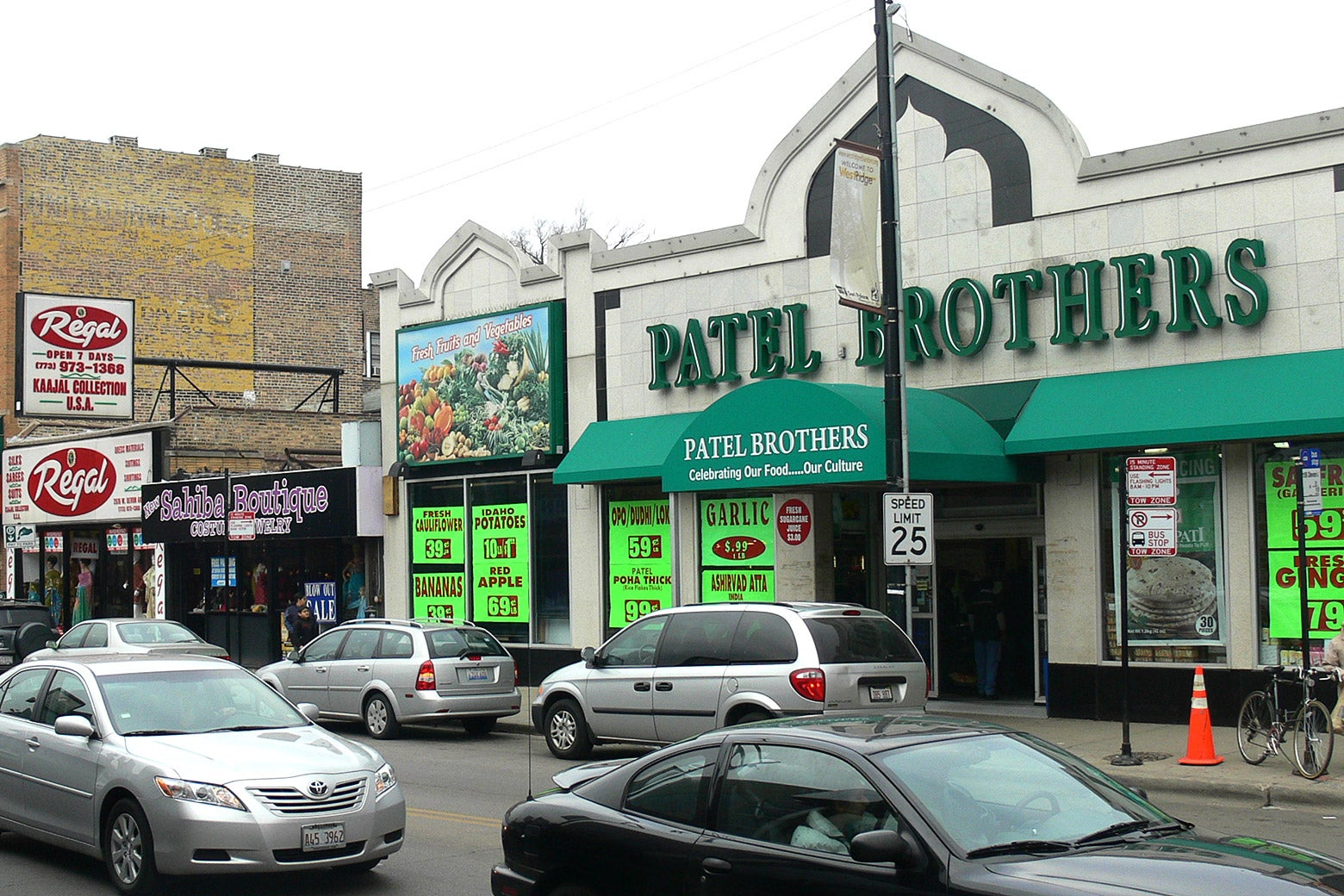 The Patel Brothers grocery store, with cars on Devon Avenue out front.