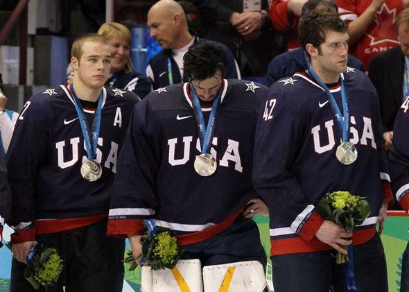 Dejected Team USA players look on after receiving the silver medal won during the ice hockey men's gold medal game between USA and Canada on day 17 of the Vancouver 2010 Winter Olympics.