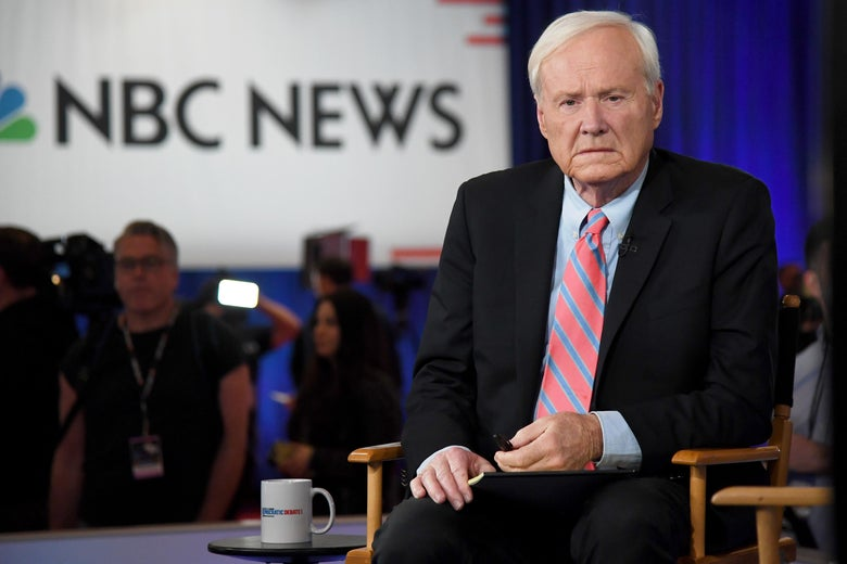 Chris Matthews seated in front of a screen displaying the NBC News logo.