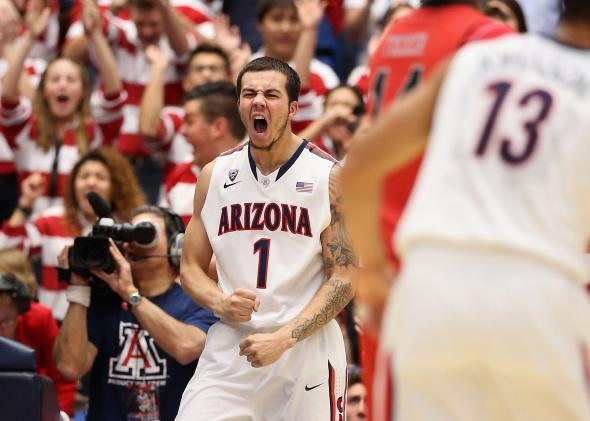 Gabe York #1 of the Arizona Wildcats celebrates after scoring against the Utah Utes during the first half of the college basketball game at McKale Center on January 26, 2014 in Tucson, Arizona.