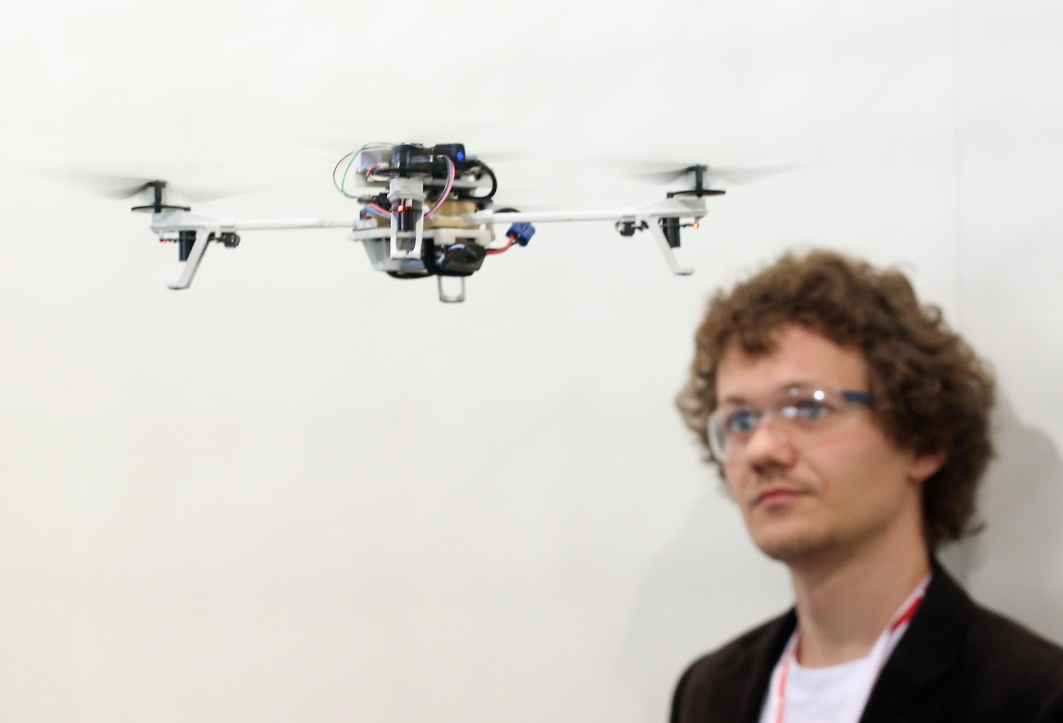 A student from the University of Zurich watches a drone.