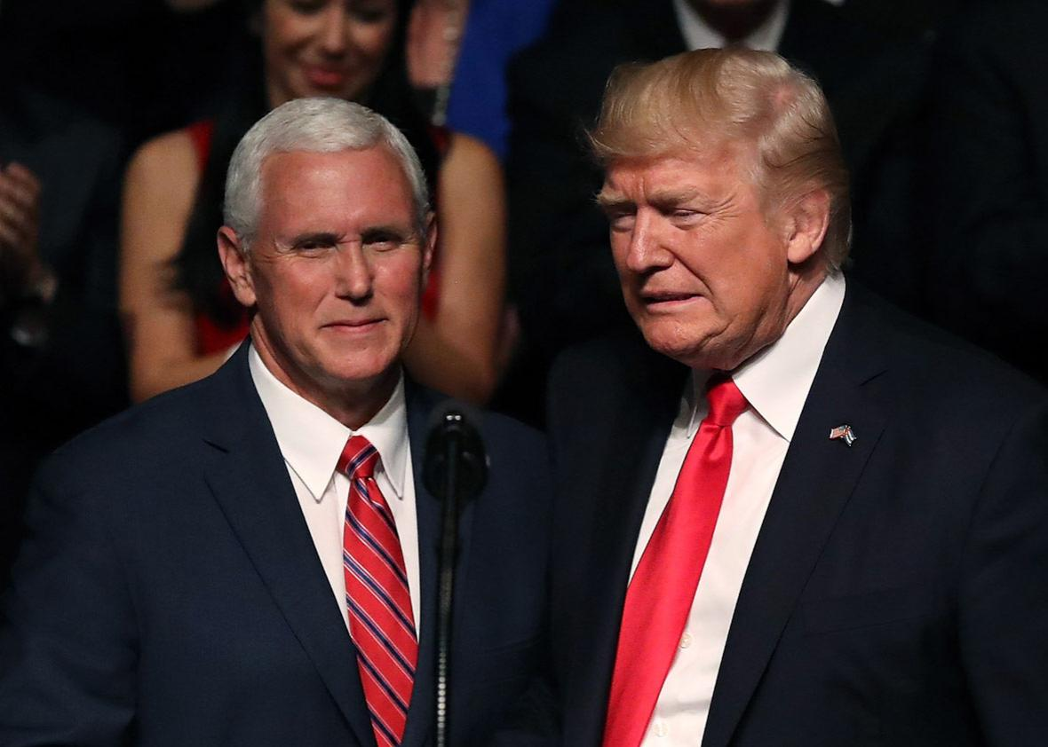 U.S. President Donald Trump (R) is introduced by Vice President Mike Pence