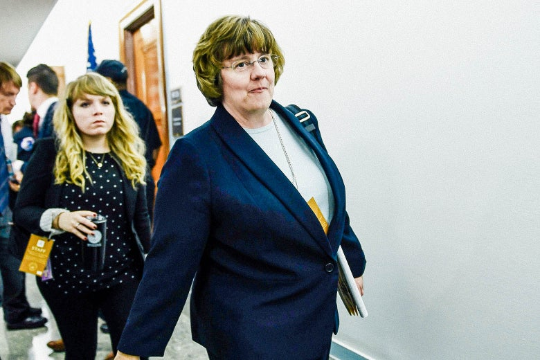 Rachel Mitchell, counsel for Senate Judiciary Committee Republicans, leaves after the Senate Judiciary Committee hearing on Thursday.