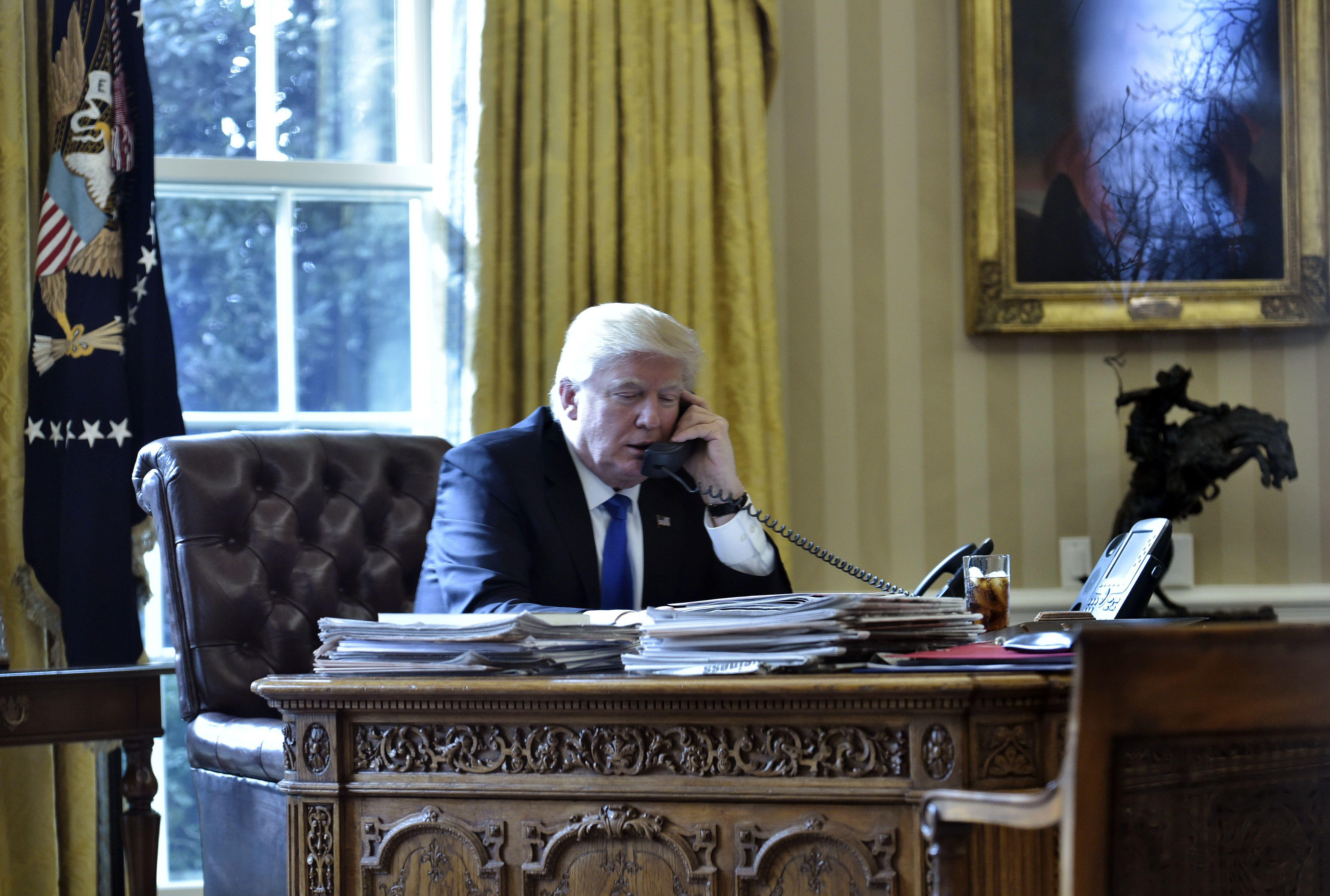 US President Donald Trump speaks on the phone with Russia's President Vladimir Putin from the Oval Office on Jan. 28, 2017