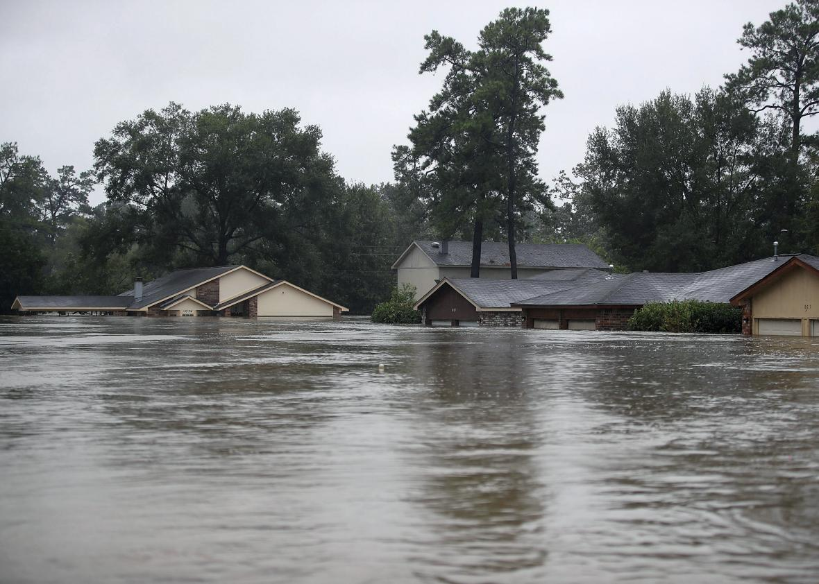 Homes are seen inundated with flooding from Hurricane Harvey on August 28, 2017 in Houston, Texas. Harvey, which made landfall north of Corpus Christi late Friday evening, is expected to dump upwards to 40 inches of rain in Texas over the next couple of days.