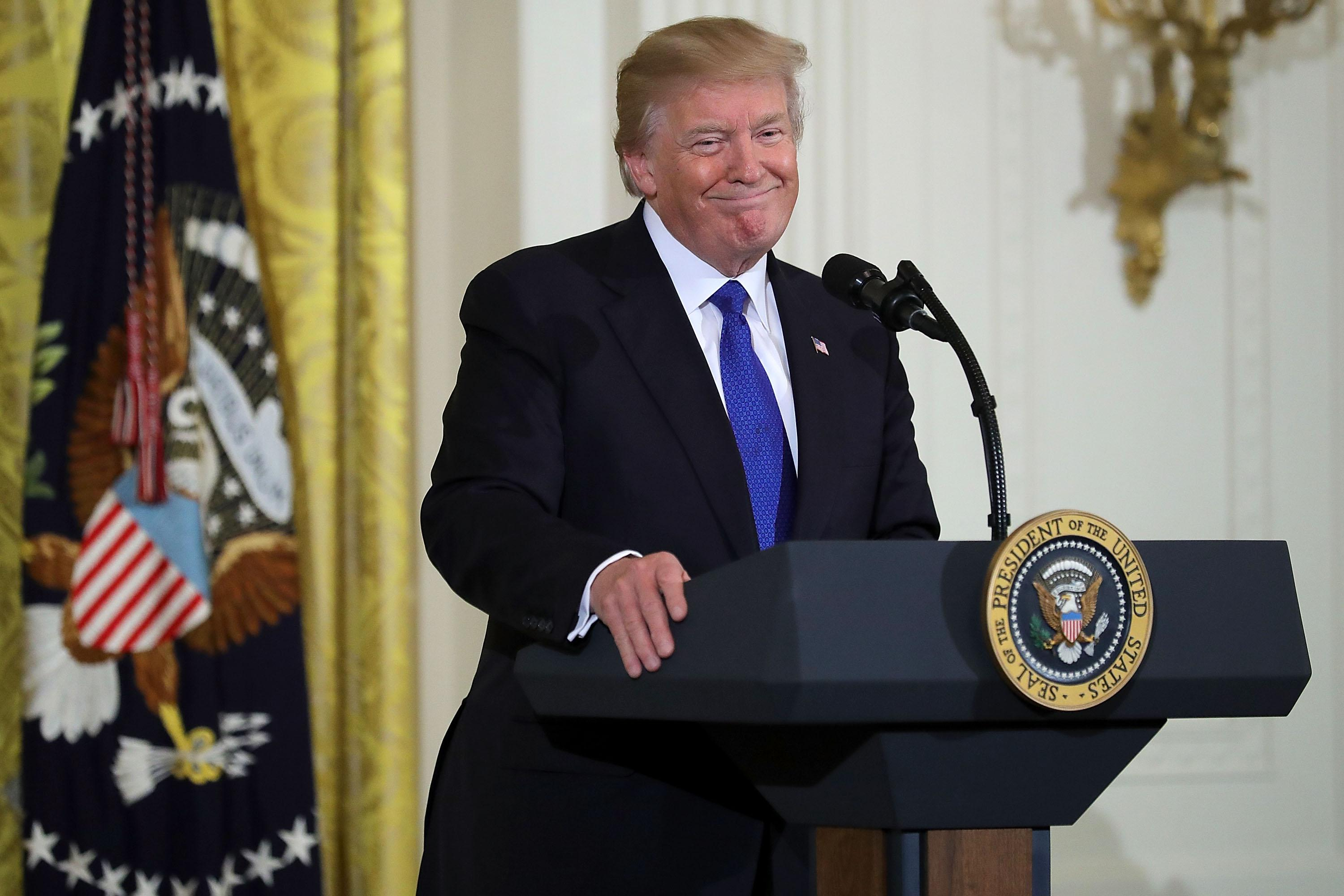 President Donald Trump speaks in the East Room of the White House January 24, 2018 in Washington, DC. According to U.S. Conference of Mayors President Mitch Landrieu, representatives from the conference were scheduled to meet with Trump but several cancelled due to the administration's 'decision to threaten mayors and demonize immigrants.' The conference, a non-partisan organization of cities with a population of 30,000 or larger, is holding its annual meeting this week in Washington.