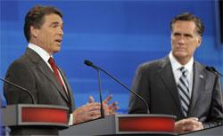 Republican presidential candidates, Texas Gov. Rick Perry (L) speaks as former Massachusetts Gov. Mitt Romney listens in the Fox News/Google GOP Debate. Click image to expand.