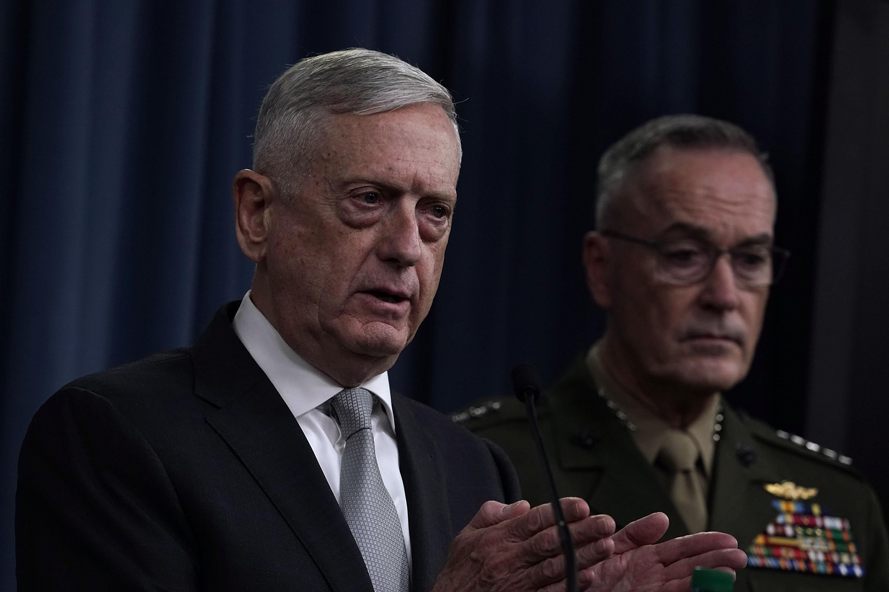 ARLINGTON, VA - APRIL 13:  U.S. U.S. Defense Secretary Jim Mattis (L) and Chairman of the Joint Chiefs of Staff Gen. Joseph Dunford (R) brief members of the media on Syria at the Pentagon April 13, 2018 in Arlington, Virginia. President Donald Trump has ordered a joint force strike on Syria with Britain and France over the recent suspected chemical attack by Syrian President Bashar al-Assad.  (Photo by Alex Wong/Getty Images)