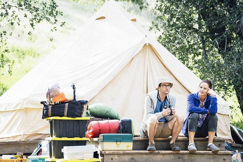 David Tennant and Jennifer Garner sit out front of a tent.