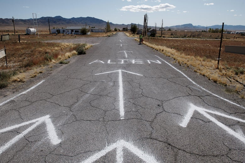 "TOPSHOT - The entrance to Alienstock festival is marked on the road in Rachel, Nevada on September 20, 2019. - A joke Facebook event named ""Storm Area 51, They Can't Stop All of Us,"" was created in June 2019. As of September 13, more than 2 million people had signed up for the event and a 1.5 million more had marked themselves as ""interested."" Multiple alien related events are now set to take place over the weekend of September 20, 2019 along state Route 375 also known as the ""Extraterrestrial Highway."" (Photo by Bridget BENNETT / AFP) (Photo by BRIDGET BENNETT/AFP via Getty Images)"