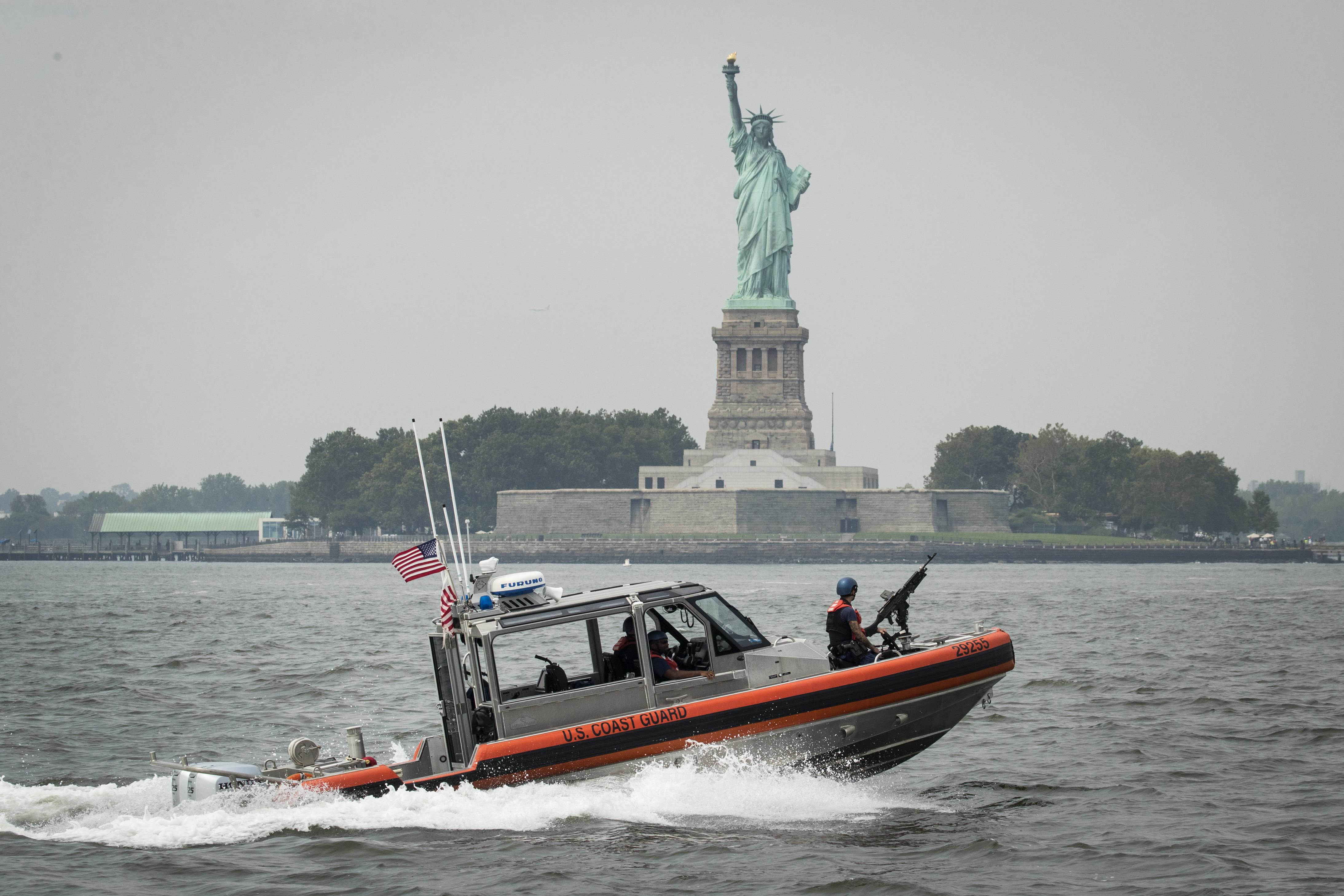 A U.S. Coast Guard boat cruises through New York Harbor near the Statue of Liberty, Aug. 27, 2018.