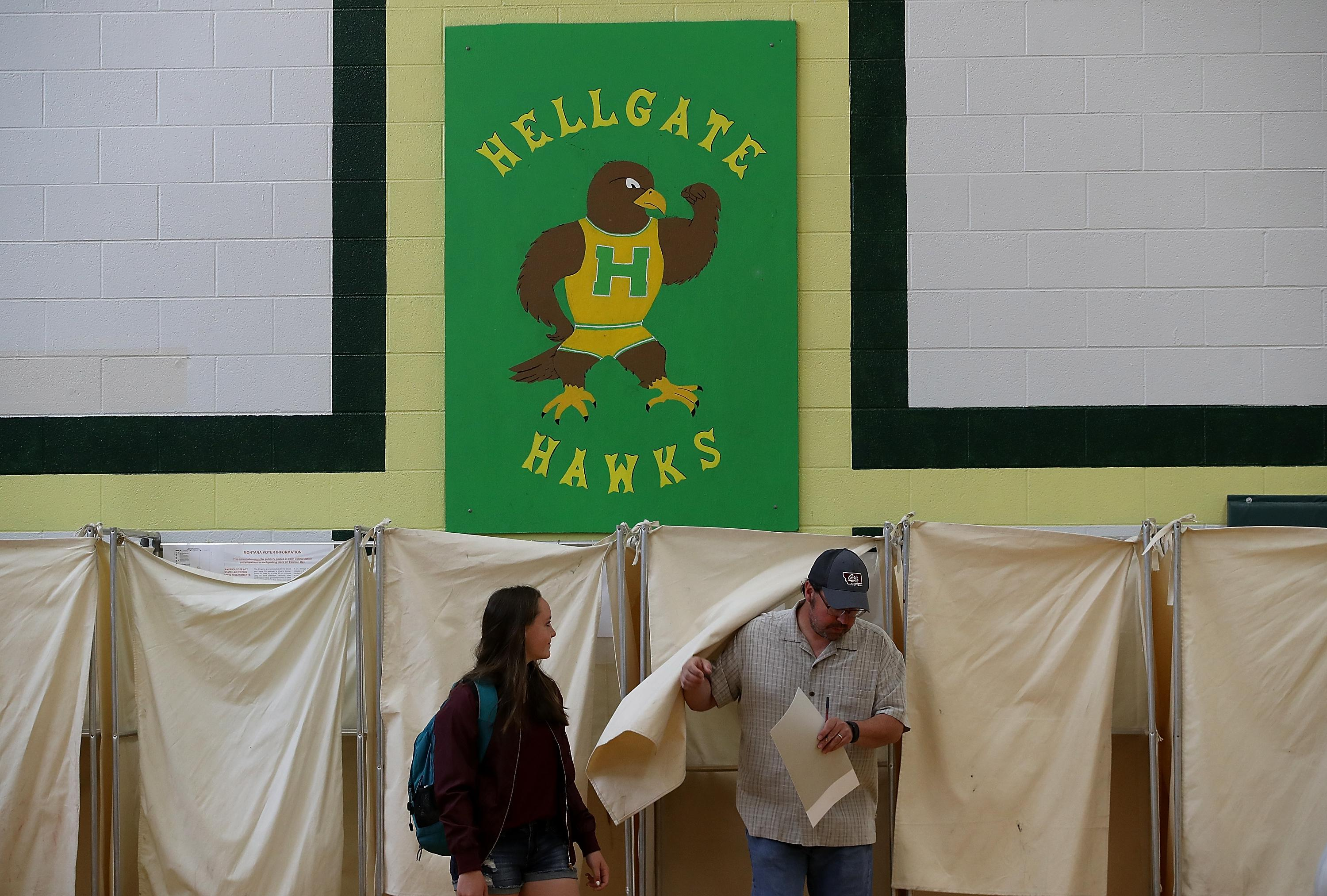 A voter exits a voting booth in a polling station at Hellgate Elementary School on May 25, 2017 in Missoula, Montana.