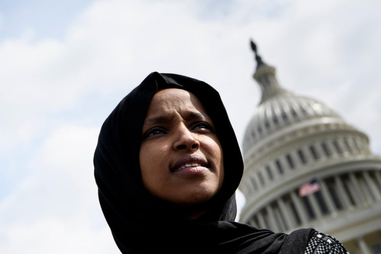 Ilhan Omar standing in front of the Capitol building.