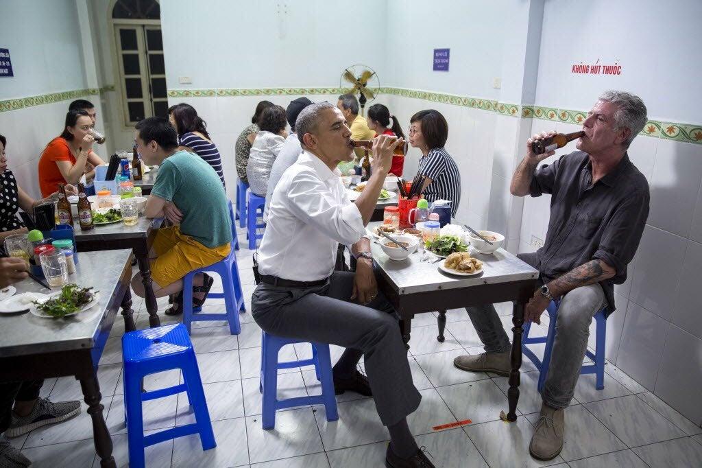 Barack Obama and Anthony Bourdain eat noodles together.