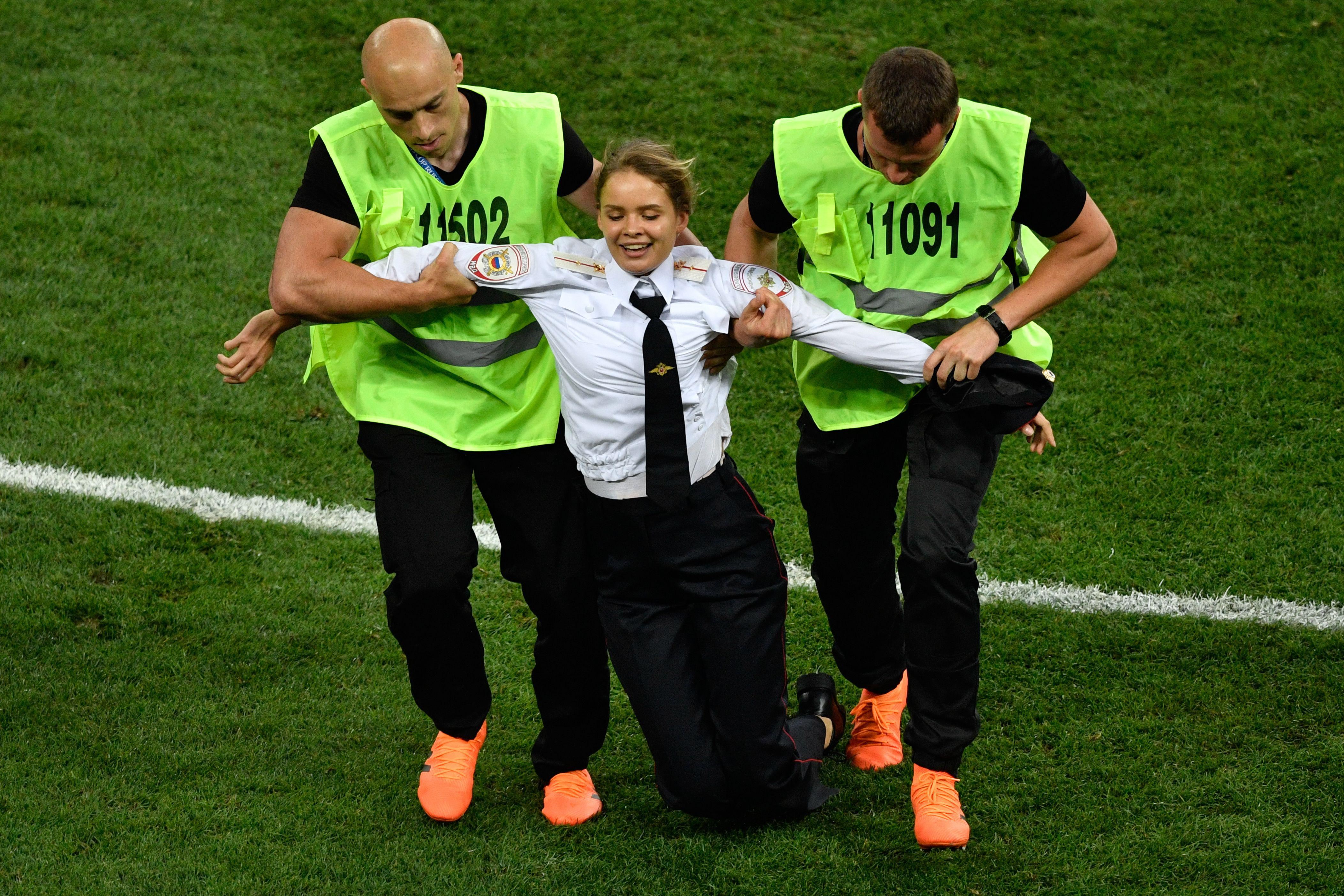 slate.com - Daniel Politi - Pussy Riot Claims Responsibility for Protest on the Field During World Cup Final