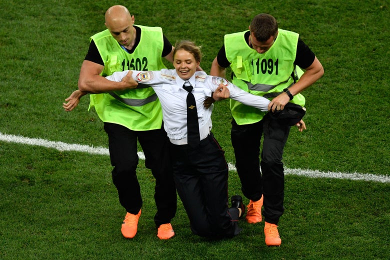3b60ec29fa2 A protester is evacuated from the football pitch during the Russia 2018  World Cup final football