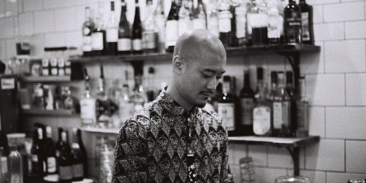 Bartender having a pensive moment.