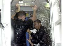 "Members of an NBC news crew take part in damage control ""wet training"" aboard USS Iwo Jima"