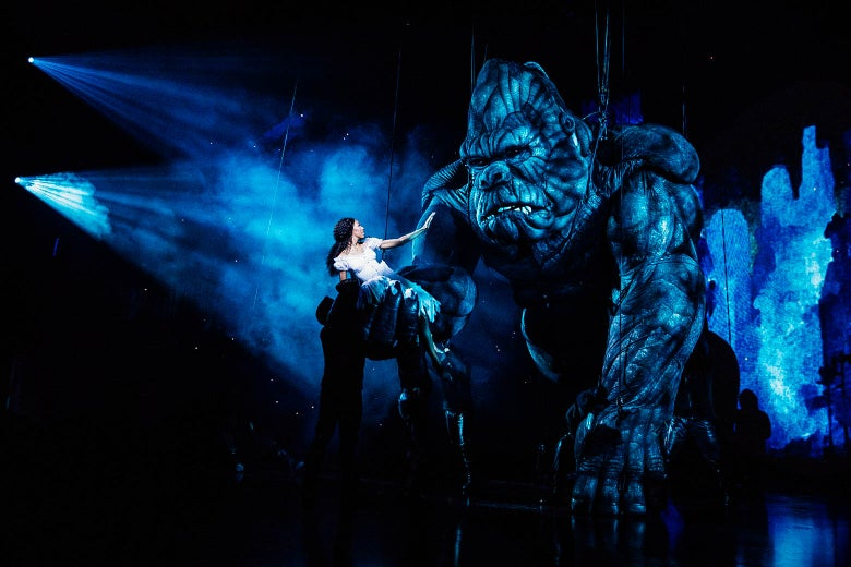 Christiani Pitts held in the hand of a large King Kong onstage.
