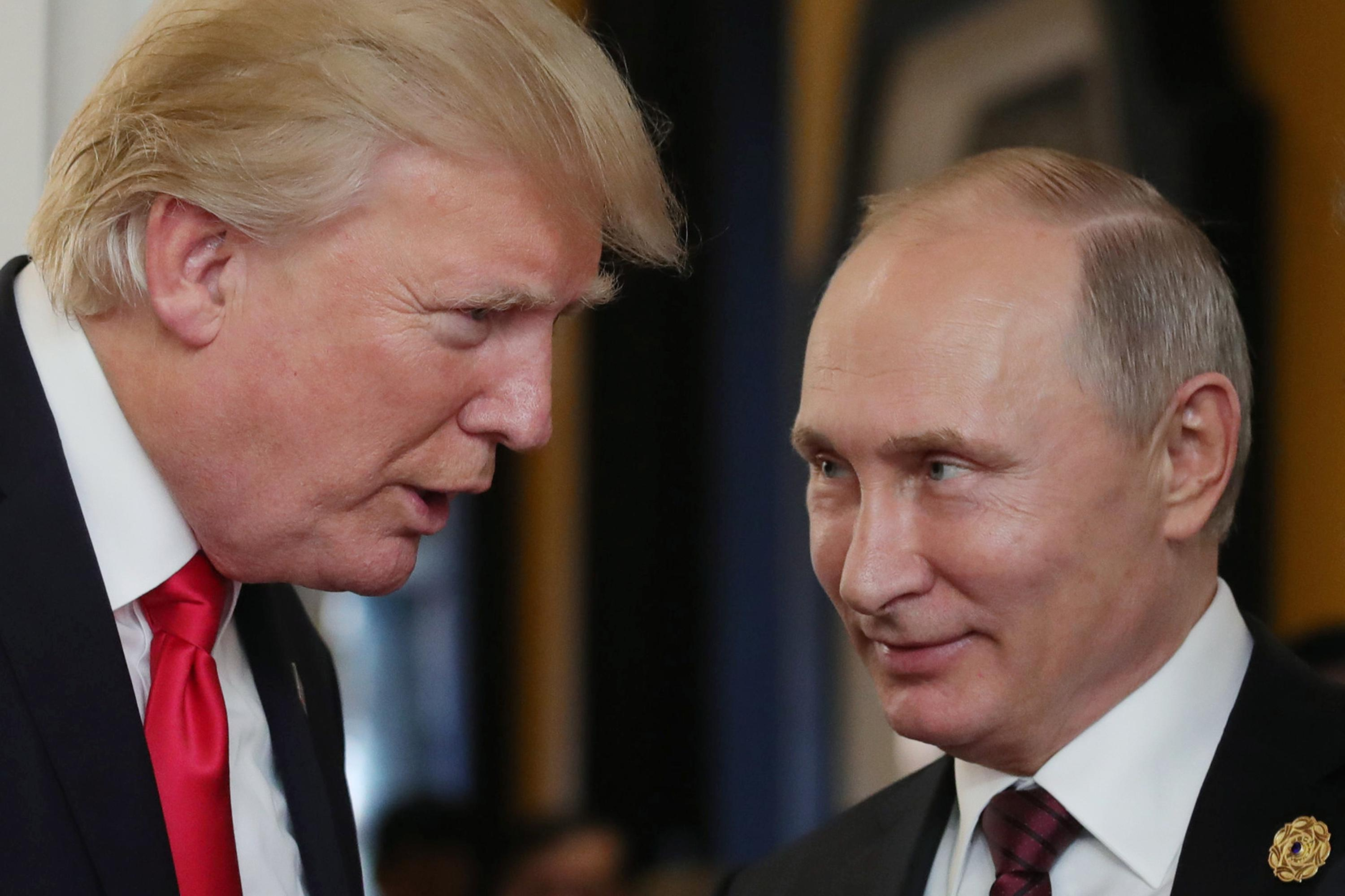 """President Trump """"chats"""" with Russia's President Vladimir Putin at the APEC Economic Leaders' Meeting on Nov. 11, 2017."""